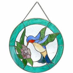 """Stained Glass Panel Sun Catcher Bird 13"""" by FantasticDecor. $27.99. Buy multiple items, save on shipping. Gorgeous Tiffany-style sun catchers will send sparkling light throughout your room. This stunning sun catcher is part of our glamorous collection of hand made glass arts in a glorious spectrum of colors. Each piece is artistically made from high quality glass. Made of stained glass. Measures 13"""" in diameter."""