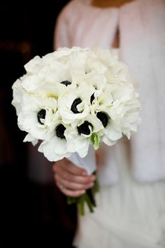 White Anemones... simple way to add color to a white bouquet.