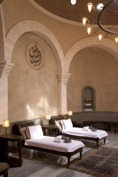 """Upscale """"hammam""""  or """"place of comfort"""" (spa) in Arabic.  Lovely architecture and wrought iron chandelier"""