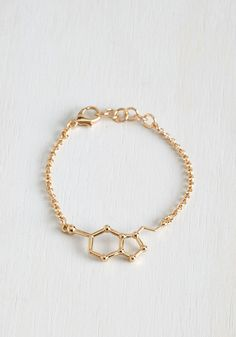 Neurotransmit Your Love Bracelet. Admirers of your ensemble will know youre especially happy to be alive when you accessorize with this golden bracelet! #gold #modcloth