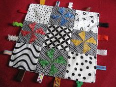 Quilted taggy blanket: use their baby cloth to make a special baby memory blanket for the older siblings