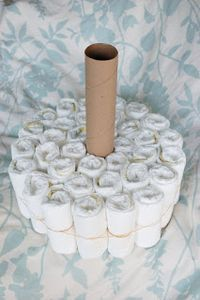 Alli Crafts: Craft Tutorial: How to Make a Diaper Cake * would be cute to do as a christmas tree for a winter baby*