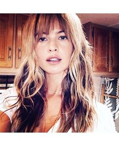 Bangs can instantly make you look chicer, younger, and fresher (especially when they're long, sultry, and uneven, like Behati Prinsloo's fringe) | allure.com