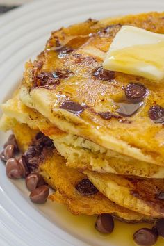 This quick and easy 20-minute chocolate chip coconut pancake recipe incorporates coconut flour, honey, coconut milk, chocolate chips and maple syrup to create the ultimate breakfast recipe. Whether you're eating this pancake recipe alongside eggs, bacon, sausage or eating it on its own, it's a great choice for a brunch recipe.#breakfastrecipes #brunchrecipes #pancakerecipes #chocolatechippancakes