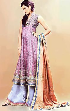 Truly beautiful drapery. With the choice of pant, this outfit manages to bridge the difference between anarkali churidar and the Muslim gharara.