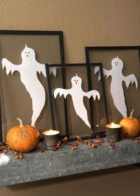 Feature friendly ghosts on a wall shelf, buffet, or mantel. Cut ghost shapes from plain white paper, marking eyes and noses with black marker. Sandwich the ghouls between sheets of glass from document frames or old picture frames, or have pieces custom-cut at a glass   store. Use black fabric tape or book-binding tape (available at crafts stores) to seal the edges. Because it can change on a whim, this framing treatment is also a great way to showcase children's art.