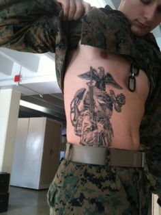 My buddy Brill's Marine Corps tattoo, sorry I dont have the artist info, he went off to training last week and I cant get ahold of him.