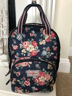 """<p>Navy floral Cath Kidston backpack with 3 pockets, one large placket, one laptop pocket and one front pocket. Adjustable straps and top carry handle. Approx dimensions: 15""""x13""""x7""""</p><p>In very good condition, with some minor wear from use as pictured: fraying to front pocket, and some discolouration, but overall in lovely condition.</p> Cath Kidston Backpack, Japanese Couple, Floral Backpack, Rucksack Backpack, Id Holder, Zip Wallet, Laptop, Handle, Backpacks"""