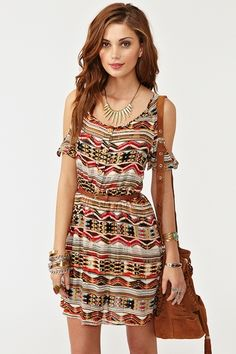 Awesome button-down dress featuring cutout shoulders and a multicolor southwest print. Front pockets, detachable brown vegan leather belt. Stretch panel at waist, unlined. Looks rad paired with a fringe bag and ankle boots!