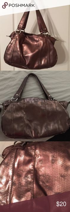 Shimmering beauty! This shimmering purse changes with light! The pattern of the material is very interesting too! With four pockets inside and one outside, plenty of room for organization. About 14' wide, 10' high, and the width 6'. Jennifer Lopez Bags
