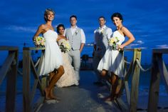beach wedding. champagne wedding dress. white bridesmaid dresses
