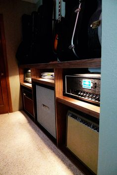 ✓ guitar amp shelves -- I'd have this be the bar countertop with a curtain to protect the amps from dropped drinks.