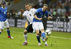 Germany's Podolski challenges Italy's Balzaretti during their Euro 2012 semi-final soccer match at the National Stadium in Warsaw. PASCAL LAUENER/REUTERS