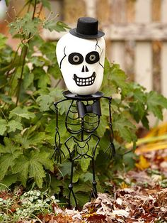 Skeleton Head Pumpkin. More No-Carved Pumpkin ideas: http://www.bhg.com/halloween/pumpkin-decorating/easy-no-carve-halloween-pumpkins/