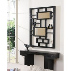 Contemporary wall mirrors have the power to transform the look of a room. Add the finishing touch to your room with this striking mirror, featuring a decorative display frame that could be used for anything from ornaments to makeup!