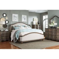 What do you think about this contemporary bedroom set? Are you a fan of the upholstered headboard and footboard?