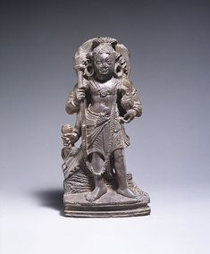 Here, the god of war is in his youthful manifestation, with a dagger secured at his waist. He holds a javelin and rooster, the latter associated with speed and aggression. The tail feathers of his peacock are visible behind his feet. Karttikeya, the God of War  Date:6th–7th century Culture:Pakistan (ancient region of Gandhara) Medium:Stone Dimensions:H. 6 3/16 in. (15.7 cm) Classification:Sculpture