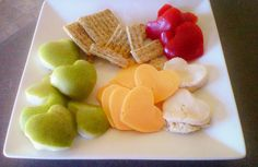 Use a heart shaped cookie cutter to make cute foods for kids lunch boxes or for a valentines party! Turkey slices, Cheddar Cheese slices, apples or other fruit, Tomatoes or other veggie and Triscuit crackers.