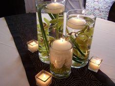 Centerpiece idea… cheap cheap cheap (i love the square votive candle holders)