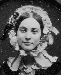 1850's bonnets   Woman in Flowered Bonnet - MET collection -beautiful face and love the smile-