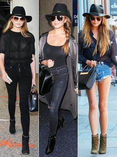 Chrissy Teigen wears a black hat with sunglasses, ankle boots and jeans with a black bag.