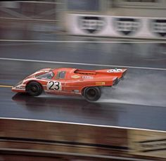 Richard Attwood and Hans Herrmann driving a Porsche 917K to victory at Le Mans in 1970