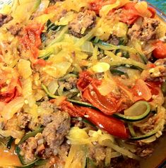 Ground Beef, Tomatoes, and Onions with Zucchini Noodles Ground beef 1 zucchini 1 sweet yellow onion 1 large or 2 or 3 small tomatoes Coconut oil or ghee Tagine (from Frontier's ethnic seasonings) Ground black pepper Garlic powder Salt