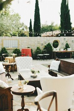 backyard party with mixed furniture