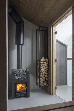 The Vindheim Cabin: Snowbound in Norway - Photo 16 of 18 - Dwell Fireplace Logs, Fireplace Design, Norwegian House, Sauna Design, Freestanding Fireplace, Wood Burner, Wood Storage, Storage Ideas, Prefab Homes