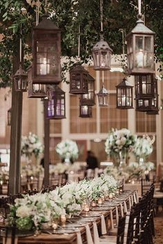 Hanging wooden lanterns for a romantic atmosphere | @shaunmenary | Brides.com