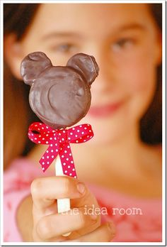 Another idea for lilys birthday I'm not much of a food craft person, but these are too cute! Minnie Mouse Pops - Split mini Oreos and stick into creme center of regular size Oreos. Insert lollipop stick, Dip whole thing in melted chocolate