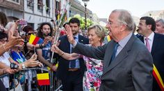 Belgium's King Albert II and Queen Paola greet the public during the last day of their 3-day farewell tour in Liege, Belgium, on Friday July 19, 2013. (AP Photo/Geert Vanden Wijngaert)