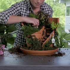 Garden Crafts Transform a broken clay pot into something stunningly impressive with this easy DIY fairy garden idea. Use moss, rocks and other fairy garden crafts to personalize your fairy garden. Here's how to make this fairy garden out of a broken pot. Broken Pot Garden, Fairy Garden Pots, Fairy Garden Houses, Gnome Garden, Garden Art, Moss Garden, Diy Fairy House, Fairy Houses Kids, Potted Garden