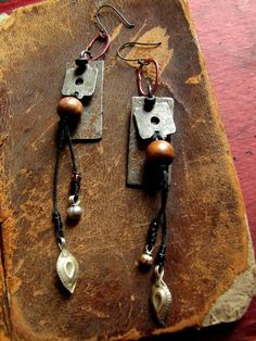 sidero  salvaged scrap metal and kuchi charm dangles by nusquam,