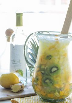 My favorite Fizzy White Wine Sangria recipe! Using tropical fruit and fizzy white wine!