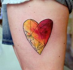 AWESOME geometric heart tattoo. The shape in itself is beautiful but the colors are breathtaking! Watercolor fading effect.