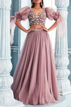 Featuring a lilac blouse in velvet and shantoon base with sweetheart neckline and organza puff sleeves. It is paired with a matching lehenga skirt in organza base. Party Wear Indian Dresses, Designer Party Wear Dresses, Indian Gowns Dresses, Indian Fashion Dresses, Dress Indian Style, Indian Wedding Outfits, Indian Designer Outfits, Party Wear Lehenga, Gown Party Wear