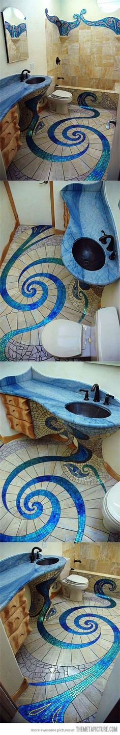 Talk about mermaid inspiration. This is a bathroom straight from underwater. These mosaic patterns are to die for!