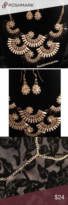 Black & Cream Fan Necklace & Earrings Set Black and Cream Fan Necklace with Crystal Accents. Matching crystal drop earrings. Gold toned metals. Glass crystals. Lobster claw closure. Nickle Free. Lead Free. Thank you for shopping @femininefashion🌹 T&J Designs Jewelry Necklaces