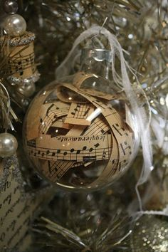 Fill empty glass ball ornaments with vintage sheet music