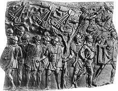 Relief from Trajan's Column shows Roman legionnaires, bottom, and barbarians, top.