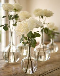 Pinning for the glass bud vases *original pin text: simple - white roses in glass vases Simple Flowers, White Flowers, Beautiful Flowers, Simple Rose, Yellow Roses, Wedding Centerpieces, Wedding Table, Wedding Decorations, Simple Elegant Centerpieces
