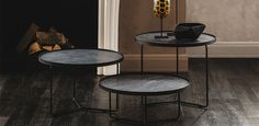 Coffee table with base in chromed steel (08), embossed black lacquered steel (GFM73) or orange fluo (FL64). Marmi Calacatta (KM01), Alabastro (KM02) or Ardesia