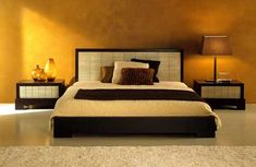 Heavy golden metallic color on the wall and Asian inspired bed makes together modern interior.