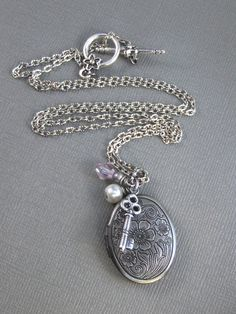 locket- i want this for mothers day with pictures of my two littles!!