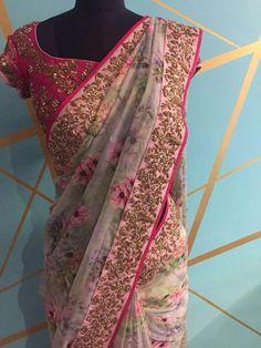 Stunning floral saree and pink color designer blouse with floral design hand embroidery zardosi and bead work. Simple Sarees, Trendy Sarees, Stylish Sarees, Fancy Sarees, Saree Blouse Neck Designs, Fancy Blouse Designs, Designer Sarees Wedding, Saree Wedding, Satin Saree