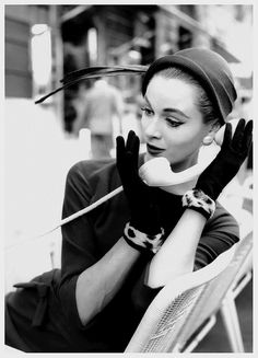 Taking a phone call in public has never looked so chic. #vintage #1950s #fashion #gloves #hat #phone