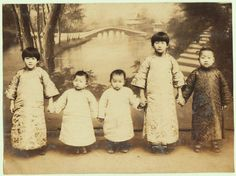 Sweet, Chinese photograph with 5 boys (the ideal of a traditional Chinese family). Studio Photo, Shanghai, 1910s.