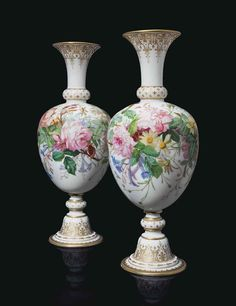 A PAIR OF BACCARAT OPALINE GLASS VASES.