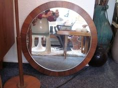 A fantastic teak mirror in typical Scandinavian style - 1960s. Extremely heavy quality. With stamp on the reverse/ hard to read. With wall